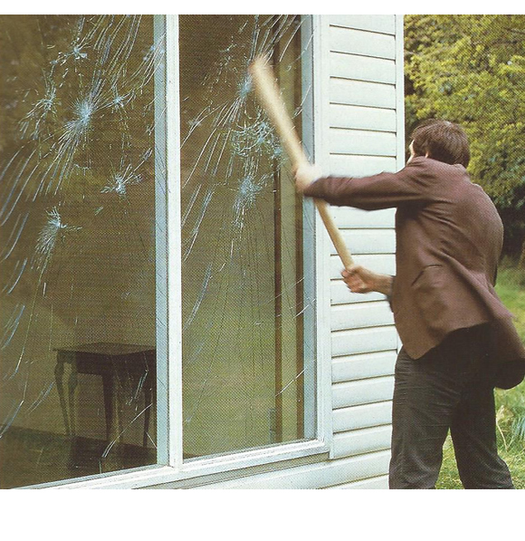 Window safety and security. Crystal clear, anti shatter, laminates, and rigid sheets to make windows safer and more secure. Photo of glazing under attack from man.