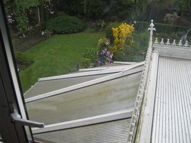Before: the conservatory panels are deteriorated and dirty and in need of replacement.