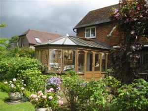 Before: the conservatory is in general poor condition.