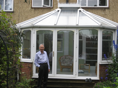 After: Mr Thomas outside his refurbished conservatory. Leaking conservatory repaired by HTG
