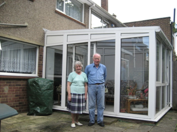After: Mr and Mrs Clarke outside their refurbished conservatory.