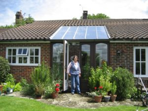 After: Miss Harris outside her 'infill' conservatory with new soar reflective HTG sealed units.