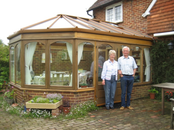 After: Mr and Mrs Norris outside their refurbished conservatory.