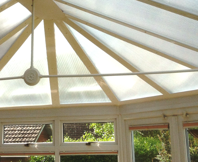 Noisy polycarbonate conservatory roof. Noisy conservatory roofs. No change to the light when a Conservatory roof is fitted with crystal clear noise reducing sheets .