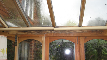 Before: The rotted beam and glazing bars are evident as well as deteriorated sealed units.