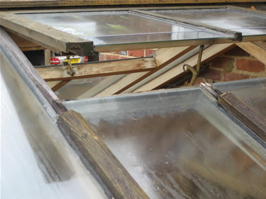 Before: poorly designed and sealed roof vent.