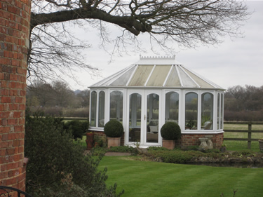 Before: the discoloured panels spoil the look of the conservatory.