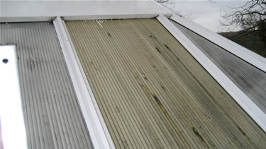 Before: The polycarbonate roof panel is discoloured and hailstone damaged.