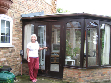 After: Mrs Oliver outside her refurbished conservatory.
