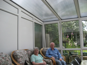 After: Mr and Mrs Clarke relax in their conservatory under the new Insu polycarbonate roof panels.