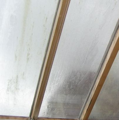Failed, misted, double glazed panels. Poor conservatory appearance.