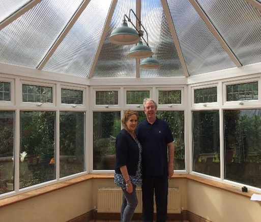 After polycarbonate conservatory roof heat reflectors have been fitted.
