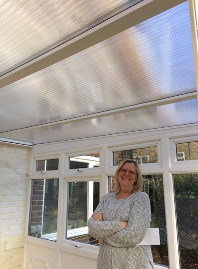 Solar inserts for a polycarbonate conservatory roof to cut heat & glare.